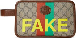 'Fake/Not' print cosmetic case