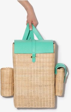 green and neutral woven straw backpack
