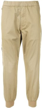 Aape Universe tapered trousers - Brown