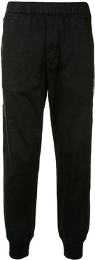 Aape Universe tapered trousers - Black