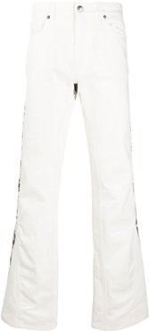 graphic print jeans - White