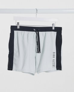 swim shorts with cut and sew design in white