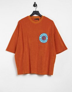 ASOS Daysocial oversized T-shirt in orange terry with badge