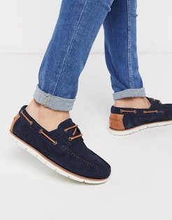 boat shoes in navy suede with white sole
