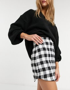 boucle mini skirt with curved hem in mono check print-Multi