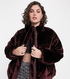 ASOS DESIGN Curve plush faux fur puffer jacket in burgundy-Red