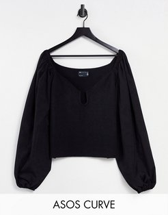 Curve sweater with plunge neck and woven sleeves in black