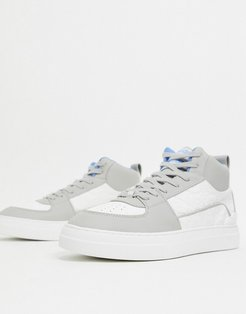high top sneakers in gray and white emboss