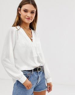 long sleeve blouse with pocket detail in Ivory-White