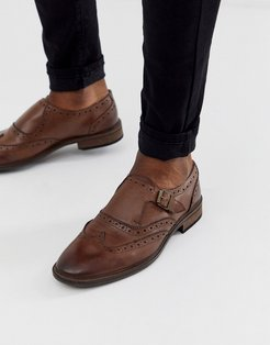 monk shoes in brown leather with brogue detail