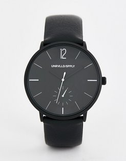 monochrome watch with black faux leather strap
