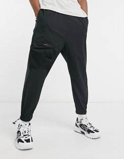 oversized tapered sweatpants with cargo pockets in black