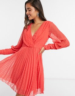 pleated wrap mini dress in dobby spot with pin tuck sleeves in red
