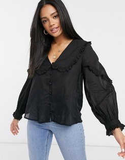 ruffle collar blouse with eyelet trim in black