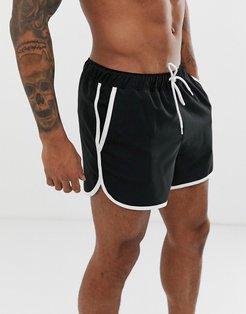 runner swim short in black with contrast white piping