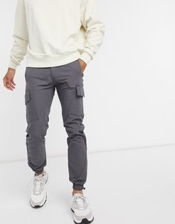 slim cargo pants with toggle hem in black ripstop