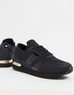 sneakers in black with gold detail