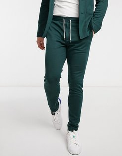 super skinny soft tailored suit pants in jersey in bottle green