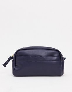 toiletry bag in navy faux leather with branded tab