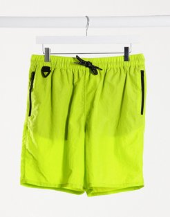 utility swim shorts in green with contrast details and drawcord mid length