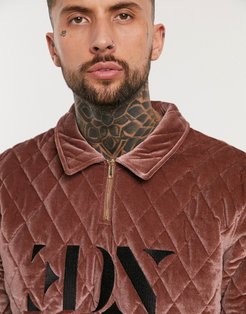 harrington sweater in burgundy quilted velvet with embroidered logo and half zip