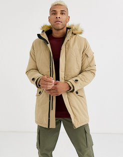 parka with fleece lined hood and detachable fur in beige