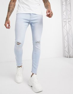 skinny jean with knee rips in light wash blue