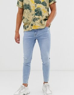 skinny jeans with knee rip in light blue
