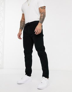ron tapered drawstring pants in cord-Black