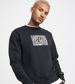 ASOS exclusive oversized sweatshirt with small white noise logo in black