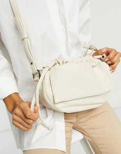 ruched half moon crossbody bag in off-white