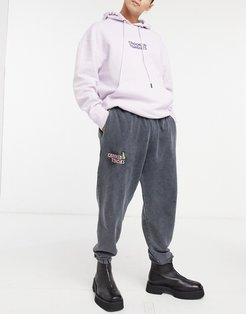 washed black sweatpants with embroidered logo