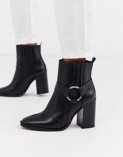 black leather heeled ankle boots with harness detail
