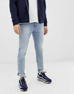 skinny fit low rise jeans in light blue wash