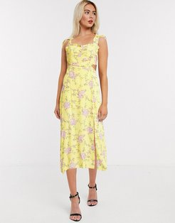 midi dress with cut out details in yellow floral