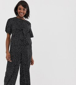 relaxed jumpsuit with tie front in spaced polka dot-Black