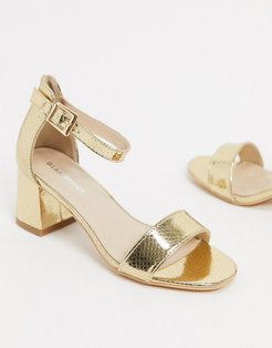 mid heeled sandals in lizard embossed gold