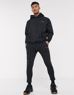 cropped tapered striped jogger in black