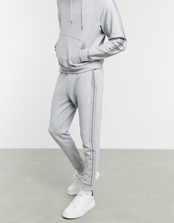 skinny sweatpants with logo and side taping in gray