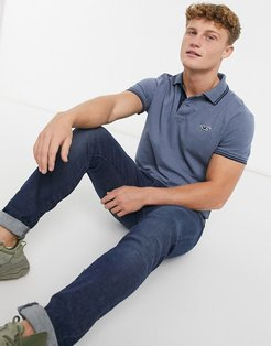 icon logo tipped pique polo in blue marl