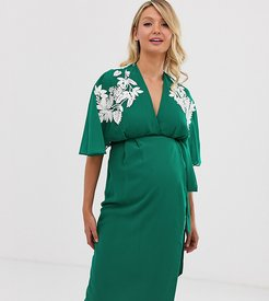 wrap front midi dress with thigh split and embellished shoulder in green