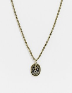 neckchain in gold with rocket tag pendant