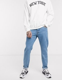 Intelligence tapered fit jeans in vintage light wash-Blue