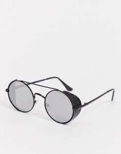 round sunglasses in black with side cap detail