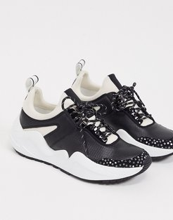 maddox jogger sneakers in black and white leather