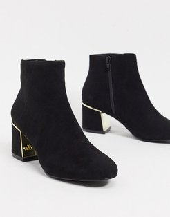 block heeled boot with gold trim detail in black