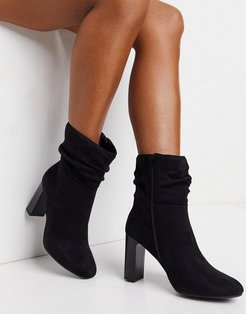 faux suede slouch heeled boot in black