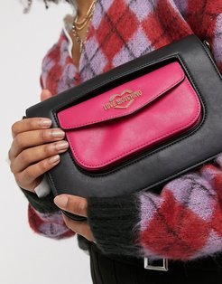 double pocket crossbody bag in black and pink