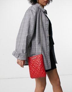 soft quilted pocket crossbody bag in red