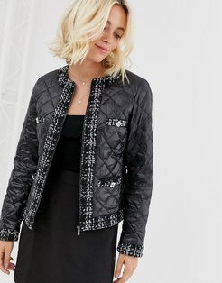 quilted jacket with check trim and pocket detail in black